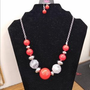 Red and white necklace with earrings
